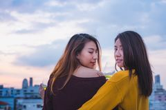 Two female lesbian lgbt couple celebrate anniversary with champa. Gne at roof top party in sunset evening time,love wins concept Royalty Free Stock Image