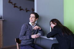 Two female and male employees discuss work and sit in office res royalty free stock photos