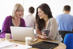 Two Female Mature Students Working Together Using Laptop Royalty Free Stock Image