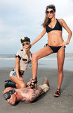 Two Female Models arrest a Guy with Tattoos Royalty Free Stock Image