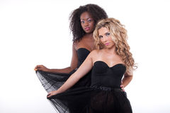 Two female models in a black transparent dress Stock Photography