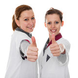 Two female nurses showing success Stock Photography