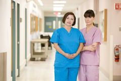 Two Female Nurses Standing In A Hospital Corridor Stock Photos