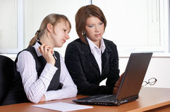 Two female in office. With laptop stock image