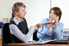 Two female in office. With laptop stock photography