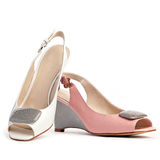 Two female open-toe shoes stock images