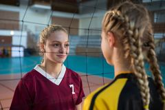 Two female player staring each other. In volleyball court Royalty Free Stock Photos
