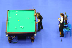 Two female players compete in pool Stock Images