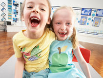 Two Female Primary Schoolchildren In Classroom Stock Images