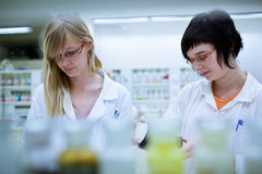 Two female researchers in a chemistry lab Stock Photo