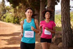 Two female runners in a race Stock Photo