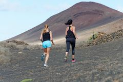Two female running athletes. Stock Images