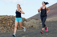 Two female running athletes. Royalty Free Stock Photos