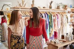 Two Female Sales Assistants Working In Independent Clothing And Gift Store royalty free stock images