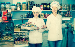 Two female sellers in confectionery Royalty Free Stock Photo