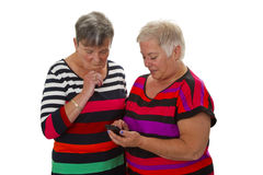 Two female senior with cellphone Royalty Free Stock Image
