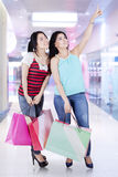 Two female shoppers in mall Stock Photos