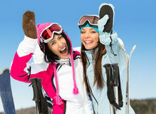 Two female skier friends with hands up Royalty Free Stock Photo