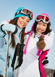 Two female skier friends thumb up Stock Photography