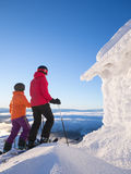 Two female skiers standing next to a frosty cabin Stock Photos