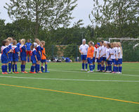 Two female soccer teams at Helsinki Cup - Helsinki, Finland - July 6, 2015. Young soccer girl teams greeting each other after the match. Photographed in Helsinki Royalty Free Stock Photos