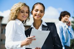 Two female students Stock Images