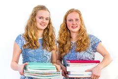 Two female students holding study books stock photos