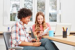 Two female students are learning together. While studying or training stock image