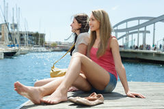 Two female students in shorts resting on the berth Stock Image