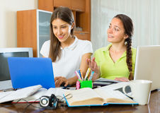 Two female students studying at home Royalty Free Stock Photo