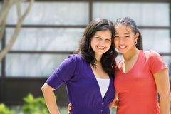 Two female teenager outside school Royalty Free Stock Image