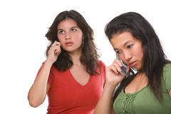 Two female teenagers on the phone Royalty Free Stock Images