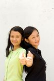 Two female teens giving thumbs up Royalty Free Stock Photo