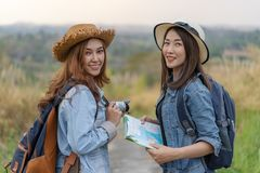 Two female tourist with backpack in countryside. Two female tourist with backpack in the countryside stock photos