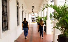 two female tourists walking in Santa Cruz de la Sierra, Bolivia royalty free stock photography