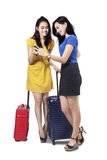 Two female travelers with cellphone Stock Photos