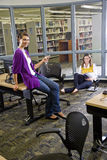 Two female university students studying in library Royalty Free Stock Photography
