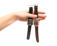 Two female wristwatches in hand. Isolated on white background Royalty Free Stock Photos