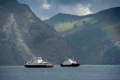 Two ferries at norwegian fjord Stock Photography