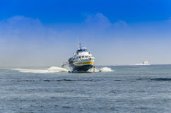 Two ferries sailing in the sea of the Aeolian Islands Royalty Free Stock Photos