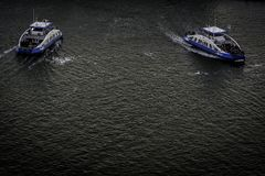 Two ferry boats passing, Amsterdam North, Nederland stock images