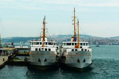 Two ferryboats docked at the pier. royalty free stock photo