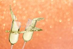 Two festive champagne glasses. Close up on pink background Royalty Free Stock Photography