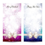 Two festive greeting cards with ribbon bow and calligraphic inscription Merry Christmas and Happy New Year. Glittering. Holiday Xmas pink and blue greeting Royalty Free Stock Photos