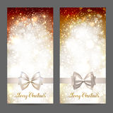 Two festive greeting cards with ribbon bow and shine gold inscription Merry Christmas. Glittering holiday Xmas greeting. Cards set Royalty Free Stock Photo
