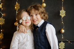Two festively dressed children photographed for Christmas card. Stock Photos