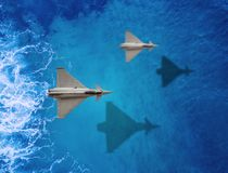 Two Fighters plane flies. Over a sea stock photos