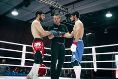 Two fighters and referee before fight Royalty Free Stock Photos