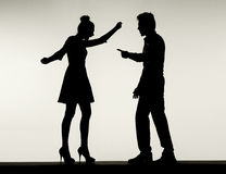 Two fighting silhouettes of the marriage couple Royalty Free Stock Photos