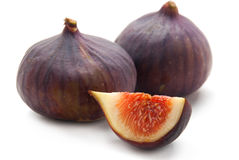 Two Figs and slice of figs. Isolated on White Background Royalty Free Stock Photos
